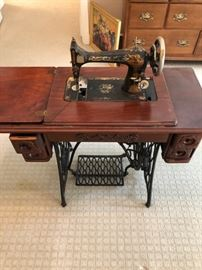 Vintage Singer sewing machine with extension table.