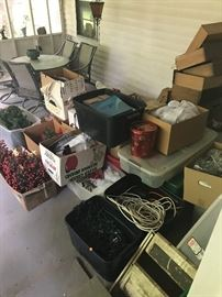 Boxes and boxes of Christmas items - collectible items sealed in tubs to be unpacked later