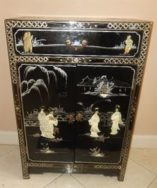 Asian chest with mother of pearl design.