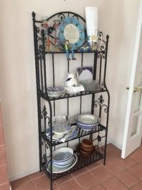 Bakers rack packed with blue and white pottery