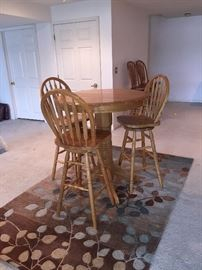 Oak pub table with 3 swivel stools