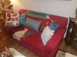 Red sofa and high end pillows and Pier 1 beaded runners