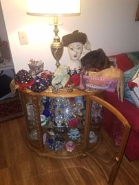 Lots of ladies purses..some hats.  Nice curio cabinet