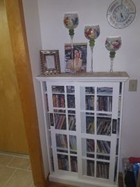 DVDs and glass door cabinet