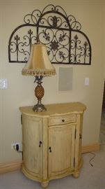 Side table, lamp, iron wall decor