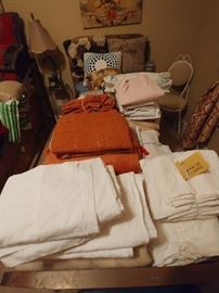 Vintage linens, pillows and quilts.
