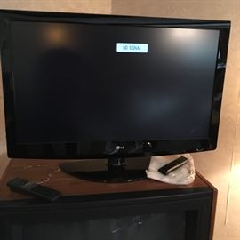 LG TV and an Older Console TV