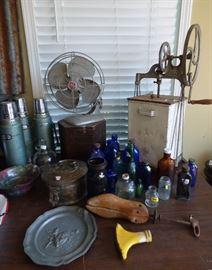 Vintage GE electric fan, Antique Dazey churn, old cobalt blue glass bottles & others,