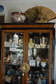 Great Asian Design China cabinet full of vintage and beautiful china and glassware.