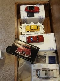 Franklin Mint VW  collection with boxes, including the Karmann Ghia.