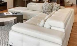 Back cushions are convertible for a sleek look when headrest mechanism is lowered.