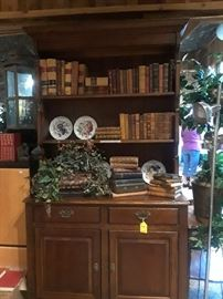 A few of the antique leather bound books and one of several display pieces for showing off your collections. Books $10 to $20 each.