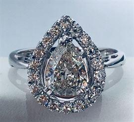 18 K white gold Ladies Diamond Ring - over one carat pear shaped diamond center stone with diamond surround