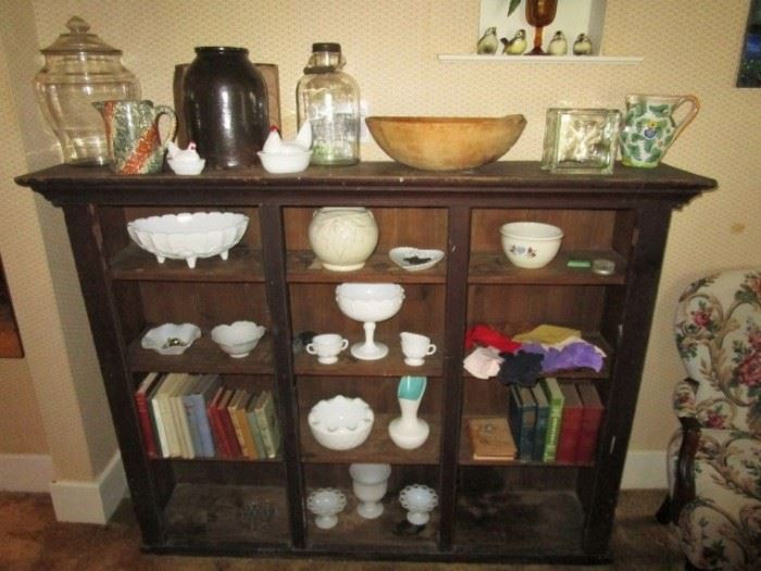 primitive cupboard top, antique stoneware, glass counter display jar, wooden bread bowl & paddle, milk glass, antique books