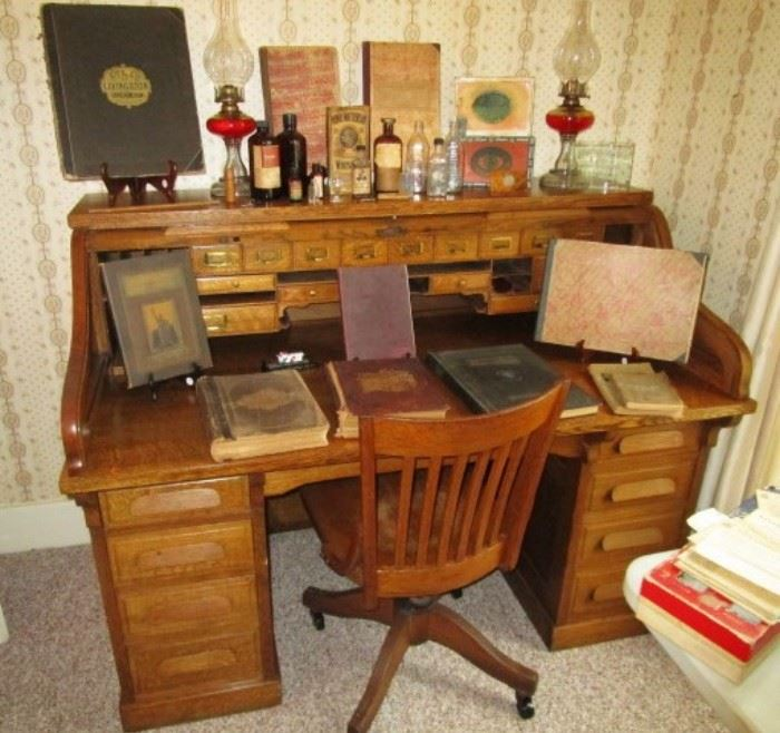 Antique roll top desk from Marshall's Dry Good store, Livingston County & Michigan Historical books, antique bottles, kerosene lamps!