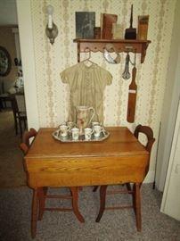 Drop leaf table, antique chocolate set, antique romper, etc.