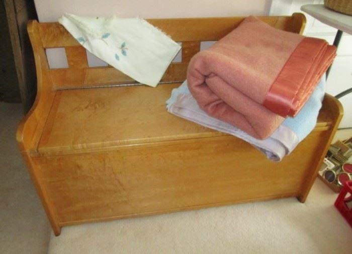 Wooden bench w/ cedar lined storage, blankets