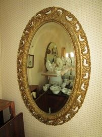 Antique beveled glass oval mirror w/ gold painted wooden frame