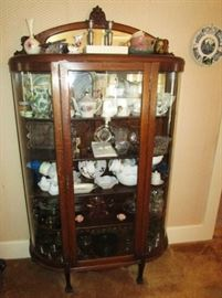 Antique curved glass china cupboard w/ carved head on top