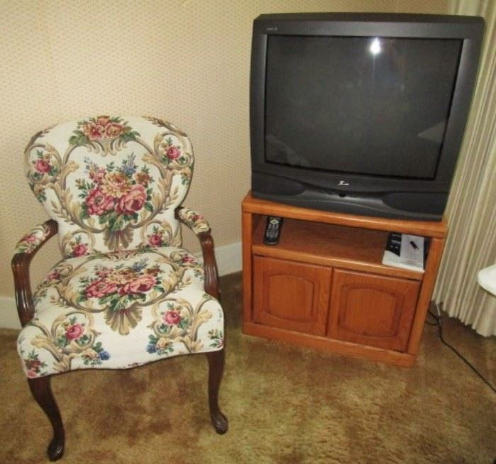 Upholstered chair, TV and cabinet
