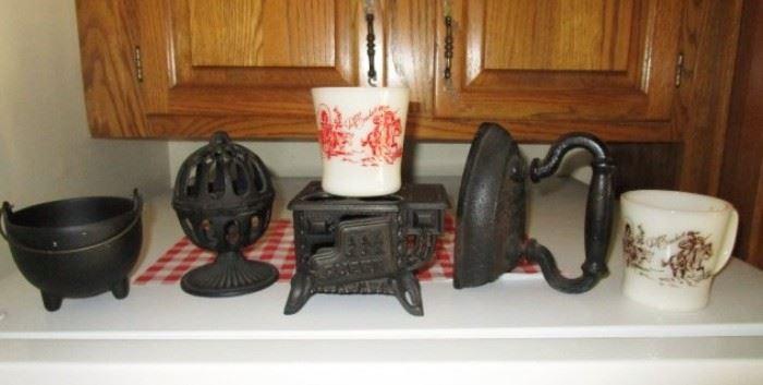 Cast iron collectibles, Fire King Davy Crockett mugs