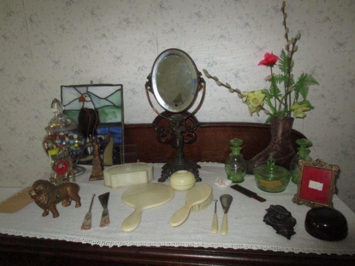 Antique dresser mirror, cast iron lion bank, celluloid dresser set, vaseline glass dresser set, vintage shoe