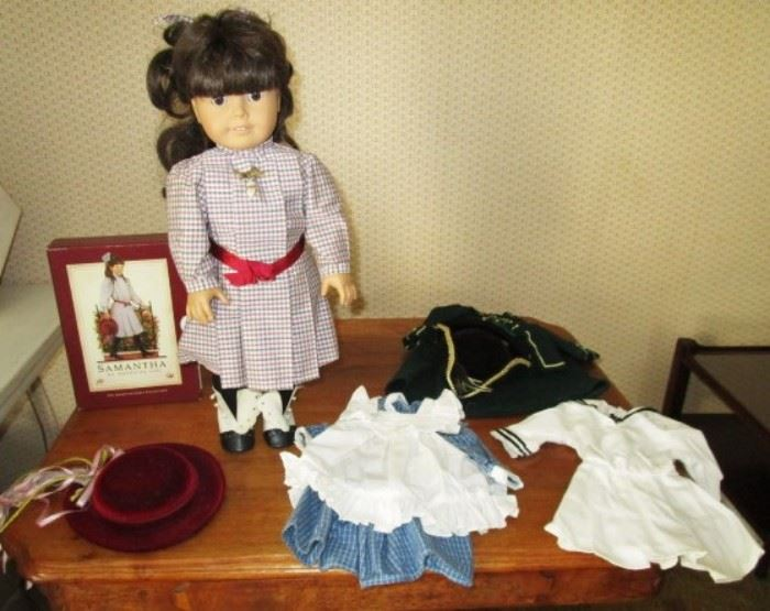 Original American Girl doll, Samantha, with book set, clothing and hat.