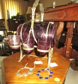 Antique purple colored glass barrel decanter w 3 glasses and stand.  Missing 3 glasses, however beautiful!