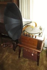 Reproduction (from 1970's) turn table w/ horn, speakers inside cabinet.