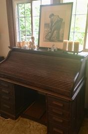 Vintage roll-top desk. Great character and details and needs some lovin.'