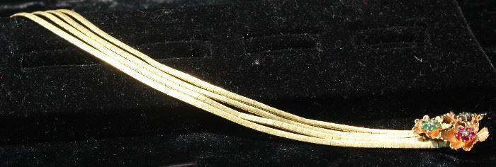 14 k gold and precious stone bracelet