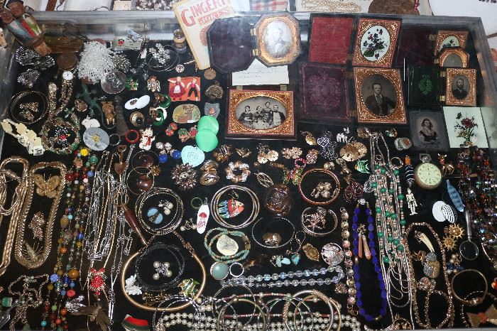 A very large selection of costume jewelry, dags and ambrotypes in cases