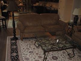 microfiber sofa, large area rug, glass top coffee table
