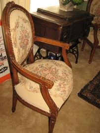 hand carved arm chairs with embroidered upholstery, vintage sewing machine
