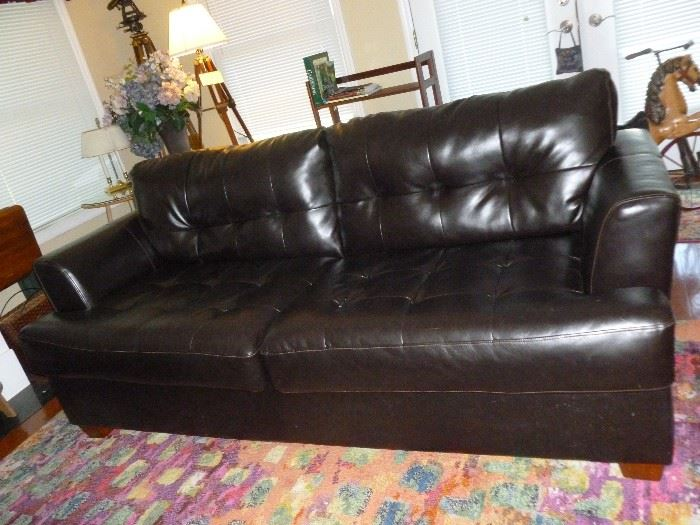 One of a pair of new vinyl (17% leather) sofas