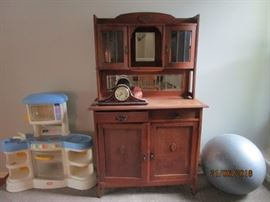 Antique cabinet with beveled glass windows