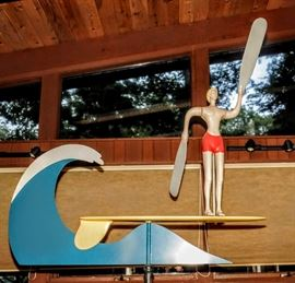 LARGE INDOOR MODERNIST WHIRLIGIG OF A SURFER BOY ON SURFBOARD AND RIDING A WAVE WOOD AND METAL WITH WEIGHTED BASE.  SIGNED NOTED ARTIST: JAMES WARREN 87