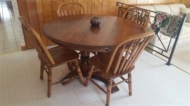 $250   Oak, round table with four chairs and 3 extra leaves