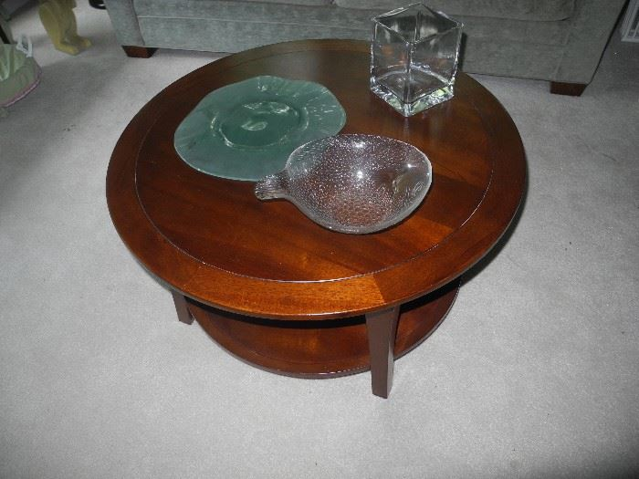 Lovely round coffee table with shelf underneath