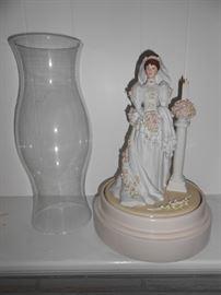 Lady in wedding dress - turns to music - box below