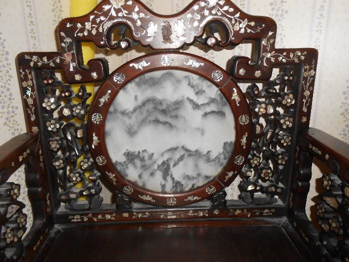 Marble circle insert - mountain scene with gorgeous carved floral climbing accents, towering on both sides.
