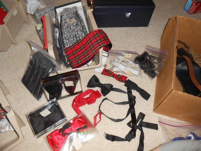 Several bow ties and cumberbunds
