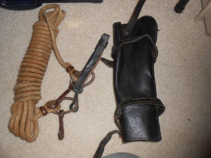 Shotgun holder for a saddle and rope