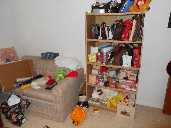 Many purses and stuffed animals