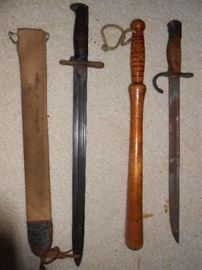 Bayonetss and billy club  - The one on the right is German made.  Both made similar to swords