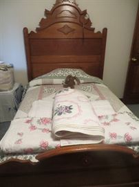 Antique 3/4 bed with mattress and box spring . Embroidered quilts.