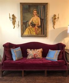 Antique Chippendale hump camel serpentine back sofa with nail head trim ,plain eight legs and plain stretcher placed a quarter of the way back. It is  7 ft 5 ins L x 3 ft 1 in H x 32 ins deep    (This portrait of Mrs Story is being kept by the family)