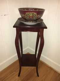 Small Bombay Co. plant stand/table and decorative bowl and plate.