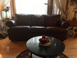 Burgundy leather couch which matches the loveseat