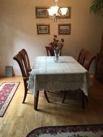 Dining room table with six matching chairs
